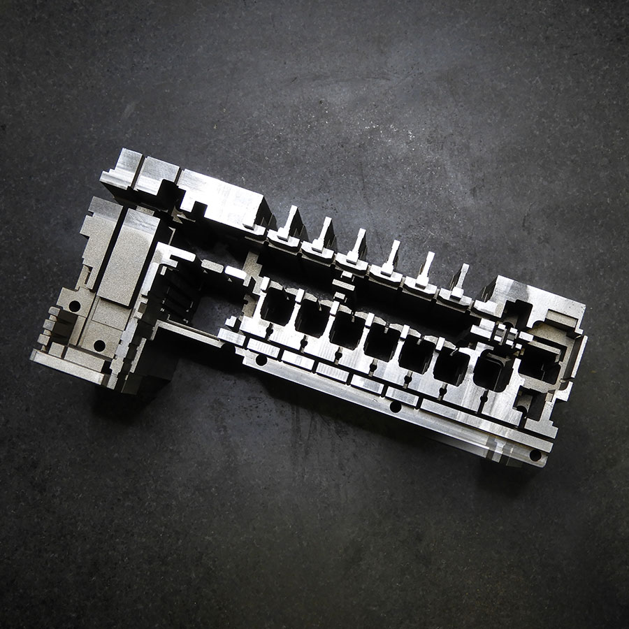 Mold part cavity for fuse box control unit made from a single block of hardened steel.